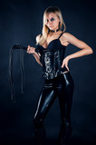 beautiful woman in a corset with a whip in hands