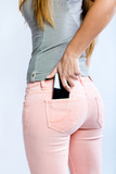 Black smartphone in back pocket of girl's jeans