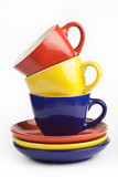 pile of colorful cups on a white background