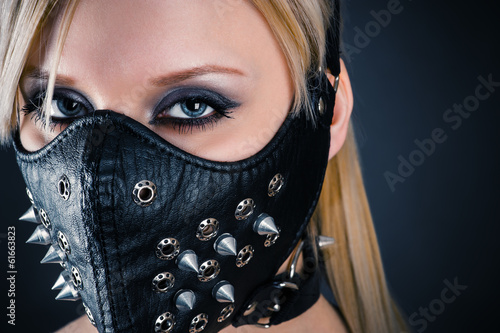 portrait of a woman slave in a mask with spikes