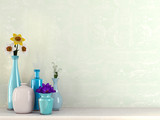 Blue vases with flowers against a green background