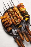 Barbecue Kebab Platter are small pieces of meat on skewers