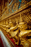 Temple of the Emerald Buddha. Gold ornamental patter statuettes