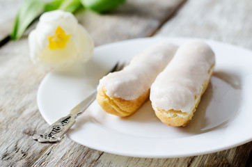 eclairs on a white plate