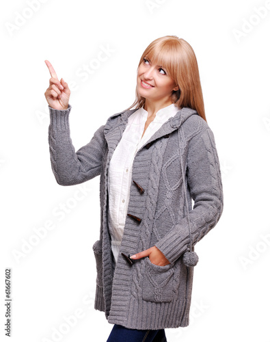 woman in a knitted cardigan pointing