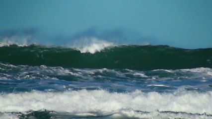 Ocean big wave sea spray blue sky