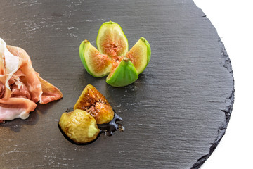 raw parma ham and figs