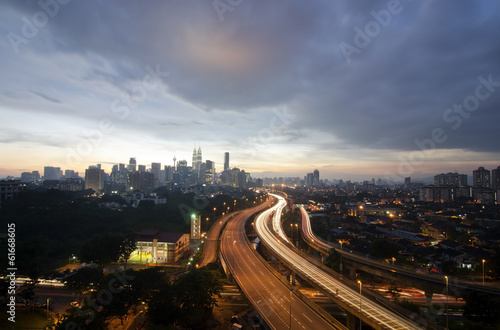 Sunset skyline of Kuala Lumpur city with Petronas Twin Towers or