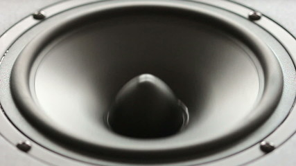 Large speaker doing a bass test in slow motion