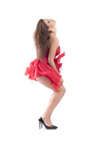 Beautiful sexy woman dancing in red flying dress