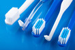 various toothbrushes over blue
