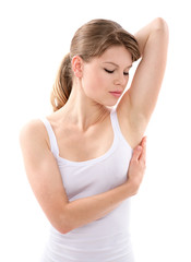 Gentle woman looking at her waxed or bared armpit, isolated