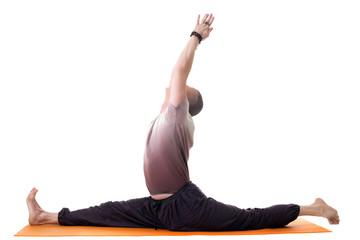 Side view of yoga trainer posing on split