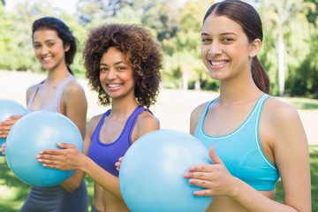 Happy women exercising with medicine balls
