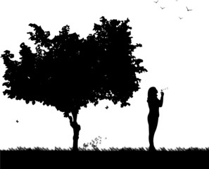 Girl blowing the dandelion in park silhouette