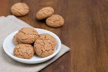 biscotti cookies in a bowl on a wooden table and space for text