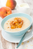 oatmeal with caramelized peaches in a bowl and jug of yogurt