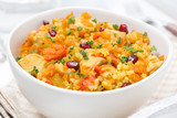 rice with vegetables, chicken and pomegranate, close-up