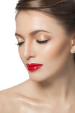 fashion portrait of a beautiful young woman with red lips
