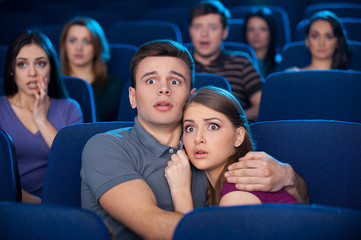 Watching horror movie.