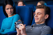 Man pirating at the cinema.
