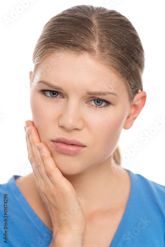 Dental care. Young woman suffering from toothache, isolated