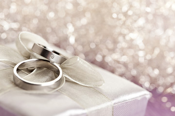 Wedding rings on silver giftbox