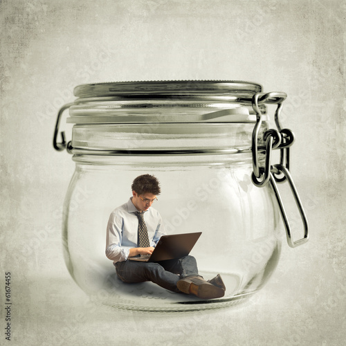 Man inside the jar with the laptop