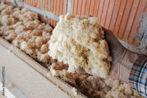 dry wood fiber blown-in in front of a brick masonry