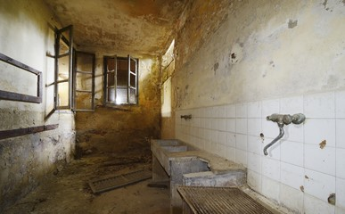 old abandoned room with sink and faucet