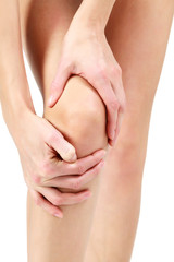 Pain in a leg, woman holding sore knee, white background