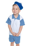 A little boy in a sailor suit