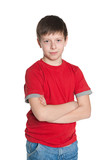 Confident young boy in red shirt