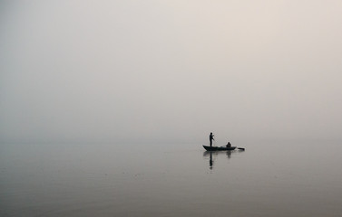 lone fisherman in the river