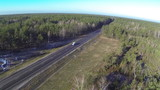Beautiful flight over  wood and  road with cars. Aerial