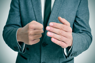 man in suit with a threatening gesture
