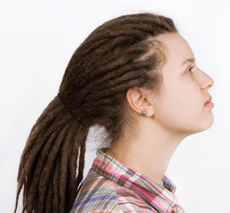 Beautiful woman with hair braided in dreadlocks