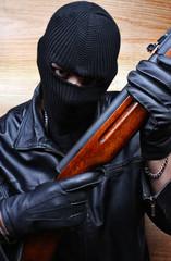 Gangster terrorist mafia criminal with a gun