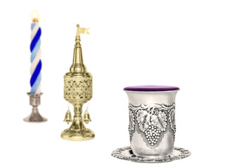 Havdalah set,selective focus on silver wine cup,horizontal.