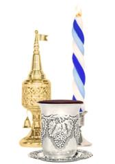 Havdalah set,selective focus on silver wine cup,vertical view.