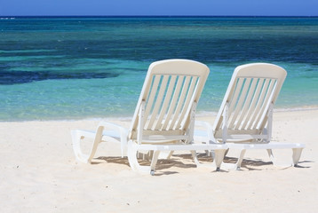Loungers facing the Caribbean Sea