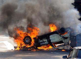 Burned car at street riots