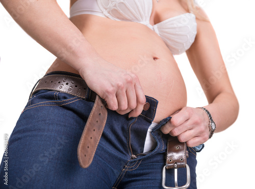 Overweight woman trying to wear jeans