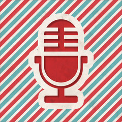 Microphone Icon on Retro Striped Background.