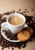 Hot coffee with cookies and beans