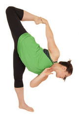 Yoga instructor balancing on one leg holding foot