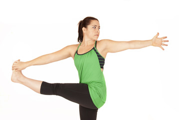 Female yoga instructor in standing twist pose Parivrtta Hasta Pa