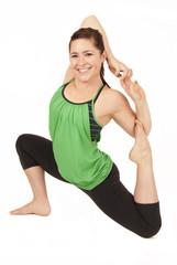 Female yoga model posing in Modified king Pigeon