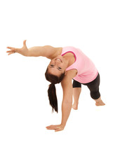 Female yoga model in Wild Thing Camatkarasana pose