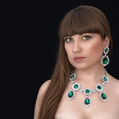 Beautiful girl with green adornment. Long hair.